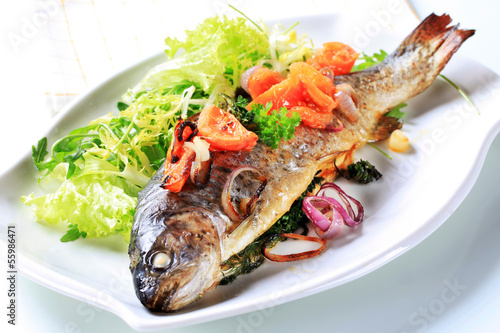 Baked trout with tomatoes and green salad
