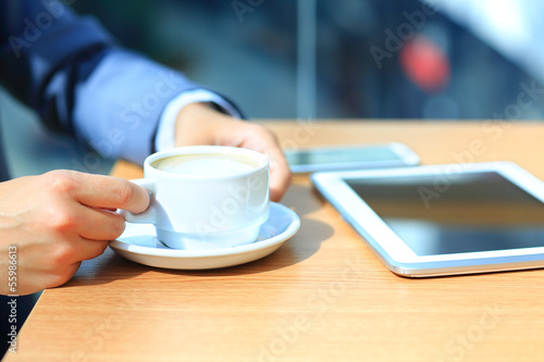 Businessman using digital tablet computer with modern mobile