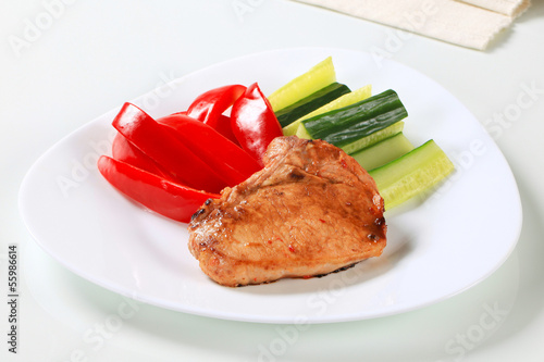 Pork cutlet with fresh vegetable sticks