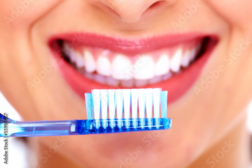 Beautiful woman with toothbrush.