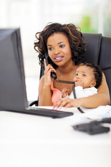 young african american businesswoman with baby at office