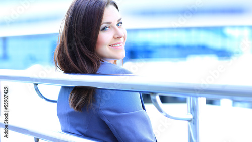 Portrait of cute young business woman outdoor