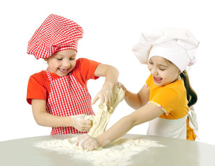 Kids with chef hats preparing tha cake dough