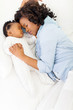 african american mother and her baby sleeping