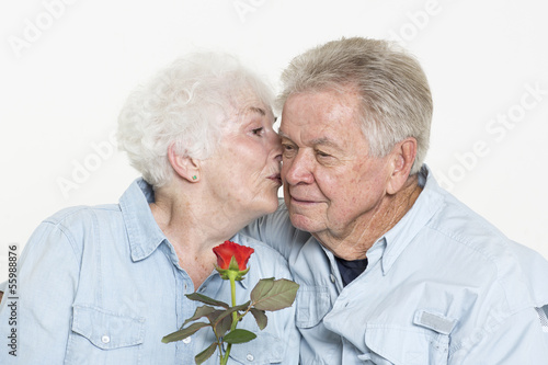 Senior woman is kissing her husband