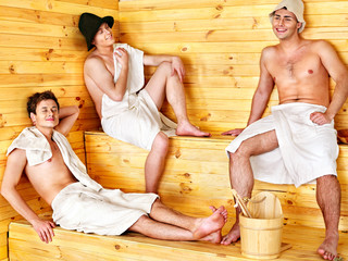 Group people in hat  at sauna.