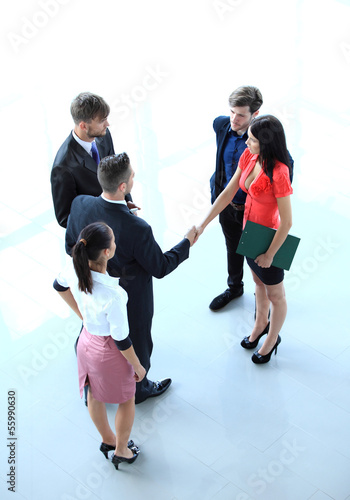 successful business men shaking hands with each other