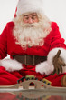 Santa Claus sitting and playing with toys