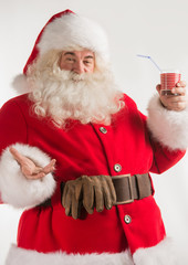 Portrait of Santa Claus Drinking milk from glass