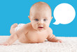 Baby lifting head with speech bubble
