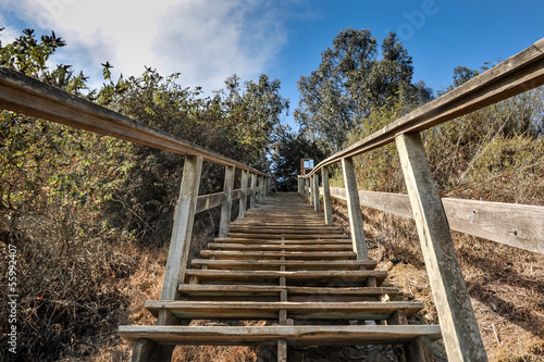 Wooden steps lead up a steep cliff