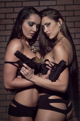 Girls in lingerie with firearms