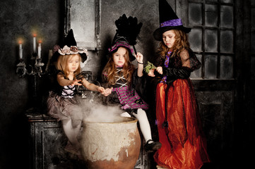 group of three Little Halloween Witch with poison, pot and magic