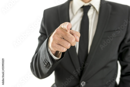 Businessman pointing finger at you