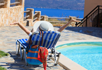 happy woman on sea vacation by the pool