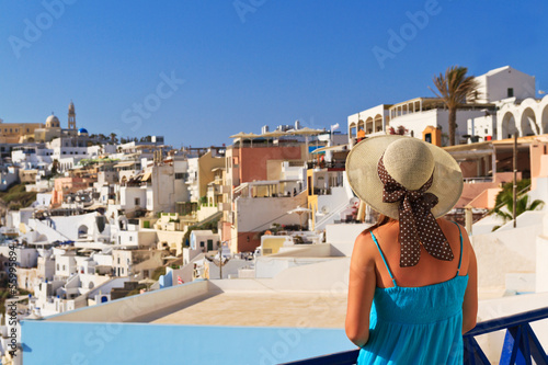 Foto op Canvas woman enjoying view of Santorini, Greece