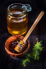 Pot of honey with lavender and a spoon for honey