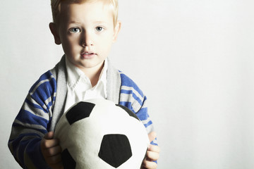 little boy with soccer ball.stylish kid. fashion children