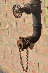 Old metal piping with valve