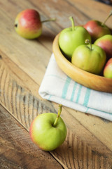 Ripe delicious apples on wooden table