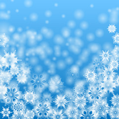 White snowflakes on a blue background.christmas background.vecto