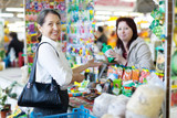 woman buys liquid fertilizer at store