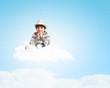 Boy sitting on cloud