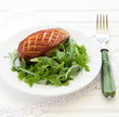 Salad with arugula and duck breast.