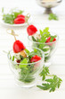 Salad with arugula, mozzarella and tomatoes.