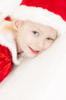 portrait of little girl as Santa Claus
