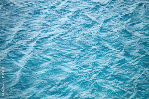 Blue sea water photo background texture with ripple © evannovostro