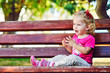 сute toddler on the bench