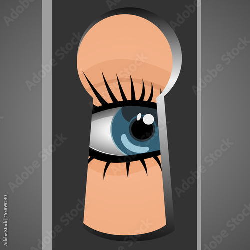 Woman looks through a keyhole