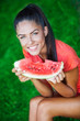 young beautiful brunette woman holding watermelon