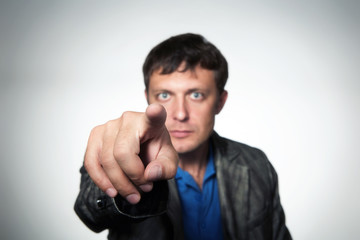 Man pointing with his finger, shallow dof