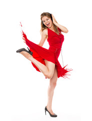 Joyful energetic woman dancer in headphones wearing red dress
