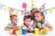 Kids with birthday cake