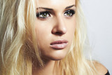 close-up beautiful blond girl with green eyes.woman.make-up