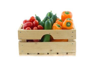wooden crate with colorful vegetables