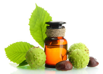medicine bottle with chestnuts and leaves, isolated on white