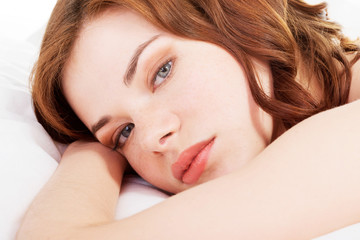 Young girl lying on a bed