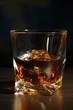 Glass of whiskey, on dark background