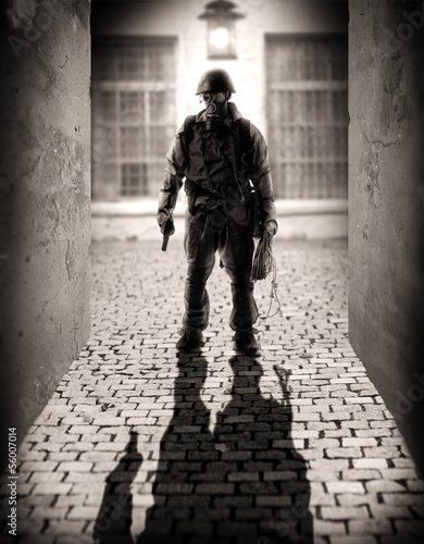 silhouette of a dangerous military men
