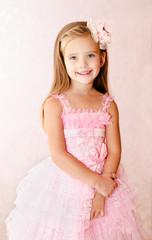 Portrait of smiling little girl in princess dress