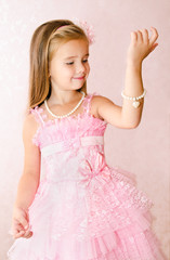 Portrait of smiling little girl in princess dress look at the br