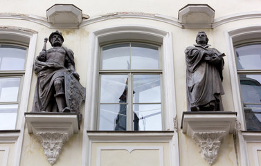 Bronze Statues on the Facade of a Historic Palace