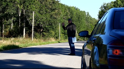 Man near car on the road with a fuel canister episode 3