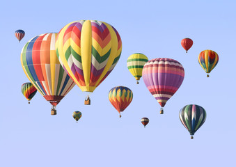 A group of colorful hot-air balloons floating