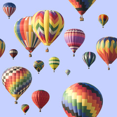 A group of colorful hot-air balloons floating across a blue sky