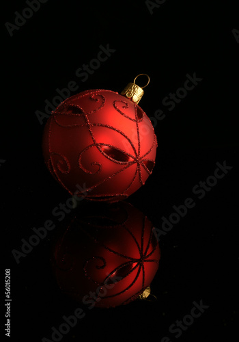 Elegant Christmas bauble on black with reflection